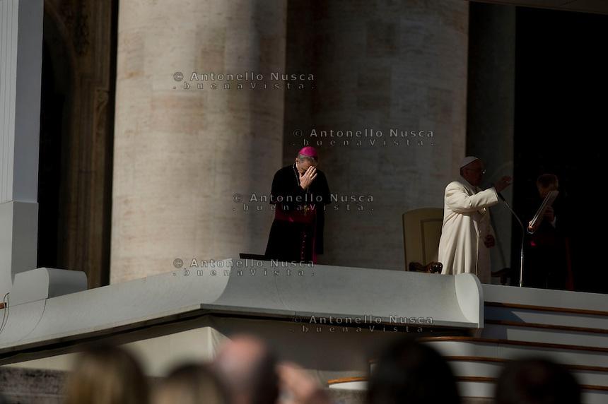 Vaticano, Novembre 2015. Mons. Georg Gänswein durante la preghiera all'udienza generale in Piazza San Pietro