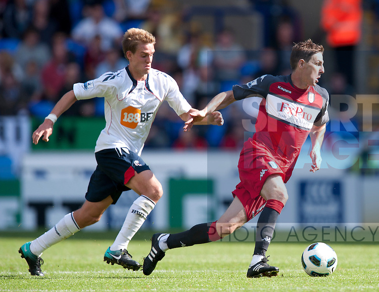 Stuart Holden of Bolton Wanderers chases Zoltan Gera of Fulham