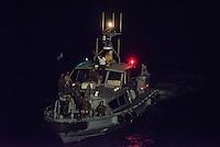 Die Sea Watch-2 Crew war am Freitag den 21. Oktober 2016 in den fruehen Morgenstunden waehrend ihrer 13. SAR-Mission vor der libyschen Kueste zu einer Position ausserhalb der 12 Meilenzone gerufen worden. Es war ein Fluechtlingsschlauchboot gesichtet worden. Als die Sea Watch-2 dort eintraf sah sie ca. 150 Menschen zusammengepfercht in einem ueberfuellten Schlauchboot sitzen. Eine Versorgung der Menschen auf dem Fluechtlingsschlauchboot mit Rettungswesten durch die Rettungs Boote der Sea Watch-2 wurde von der libyschen Kuestenwache unterbunden. Ein Soldat der Kuestenwache enterte das Schlauchboot vom Bug und machte sich dann an dem Aussenbordmotor zu schaffen. Auf dem Weg dahin schlug und trat er die Gefluechteten ein. Nach einigen Minuten entfernte sich das Boot der Kuestenwache. Dann verlor der Bug des Schlauchbootes seine Luft und es brach Panik bei den Gefluechteten aus. Sie sprangen in das Wasser und versuchten zum Schiff Sea Watch-2 zu gelangen. Die Crew warf ihnen Schwimmwesten und Rettungsringe zu, die Besatzungen der Rettungsboote der Sea Watch-2 zogen Menschen aus dem Meer, dennoch sind bis zu 30 Menschen ertrunken. Vier Ertrunkene konnten von der Sea Watch geborgen werden.<br /> Im Bild: Das Boot der Libyschen Kuestenwache.<br /> 21.10.2016, Mediterranean Sea<br /> Copyright: Christian-Ditsch.de<br /> [Inhaltsveraendernde Manipulation des Fotos nur nach ausdruecklicher Genehmigung des Fotografen. Vereinbarungen ueber Abtretung von Persoenlichkeitsrechten/Model Release der abgebildeten Person/Personen liegen nicht vor. NO MODEL RELEASE! Nur fuer Redaktionelle Zwecke. Don't publish without copyright Christian-Ditsch.de, Veroeffentlichung nur mit Fotografennennung, sowie gegen Honorar, MwSt. und Beleg. Konto: I N G - D i B a, IBAN DE58500105175400192269, BIC INGDDEFFXXX, Kontakt: post@christian-ditsch.de<br /> Bei der Bearbeitung der Dateiinformationen darf die Urheberkennzeichnung in den EXIF- und  IPTC-Daten nicht entfernt werden, diese sind in digitalen M