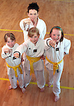 Marese Farrell with Jenny Willis, Emma McCarthy and Emma Flanagan who got their double promotion to Yellow Belt at Sheild Taekwondo Club...Photo NEWSFILE/Jenny Matthews.(Photo credit should read Jenny Matthews/NEWSFILE)....This Picture has been sent you under the condtions enclosed by:.Newsfile Ltd..The Studio,.Millmount Abbey,.Drogheda,.Co Meath..Ireland..Tel: +353(0)41-9871240.Fax: +353(0)41-9871260.GSM: +353(0)86-2500958.email: pictures@newsfile.ie.www.newsfile.ie.FTP: 193.120.102.198.