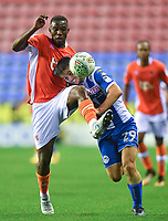 Blackpool's Viv Solomon-Otabor battles with Wigan Athletic's Luke Burke<br /> <br /> Photographer Dave Howarth/CameraSport<br /> <br /> The Carabao Cup - Wigan Athletic v Blackpool - Tuesday 8th August 2017 - DW Stadium - Wigan<br />  <br /> World Copyright &copy; 2017 CameraSport. All rights reserved. 43 Linden Ave. Countesthorpe. Leicester. England. LE8 5PG - Tel: +44 (0) 116 277 4147 - admin@camerasport.com - www.camerasport.com