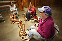 NWA Democrat-Gazette/DAVID GOTTSCHALK Amanda Quinney (from left), spins a mix of homegrown mohair and local wool with Mary Neligh, spinning rose fiber, and Kathleen McGill, spinning alpaca, Wednesday, February 6, 2019, during a Spin-A-Round meeting of the Wool and Wheel Handspinners in the Latta Barn at Prairie Grove Battlefield State Park. The group meets every first Wednesday of the month at the park and every third Saturday at Ozark Folkways in Winslow. The group is open to the public and invites participation and observation.