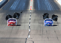 Feb 25, 2017; Chandler, AZ, USA; NHRA pro stock driver Greg Anderson (left) races alongside teammate Jason Line during qualifying for the Arizona Nationals at Wild Horse Pass Motorsports Park. Mandatory Credit: Mark J. Rebilas-USA TODAY Sports