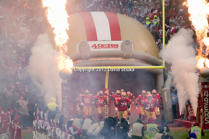 San Francisco 49ers run onto the field during introductions prior to the NFC Championship NFL football game against the New York Giants on January 22, 2012 in San Francisco, California. The Giants won 20-17 in overtime. (AP Photo/David Stluka)