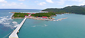 Panoramic View of Labadee, Haiti, a private resort island leased by Royal Caribbean International, on the northern coast of Haiti on Thursday, December 15, 2011 taken from a top deck of the Celebrity Silhouette.  Royal Caribbean has contributed the largest proportion of tourist revenue to Haiti since 1986.  It pays the Hatian government $6.00 per tourist.  This image is a compilation of 4 photos stitched together in PhotoShop to create a panoramic view of the resort..Credit: Ron Sachs / CNP