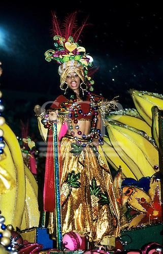Rio de Janeiro, Brazil. Carnival samba school parade; woman in bright multicoloured metallic costume