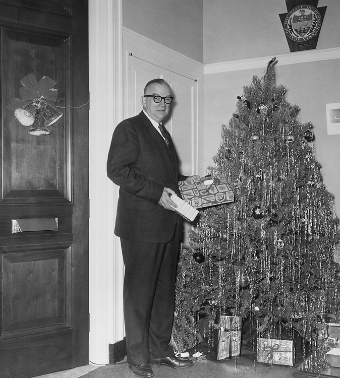 Rep. Michael J. Kirwan, D-Ohio, standing beside the Christmas tree with gifts in hand. (Photo by CQ Roll Call via Getty Images)