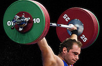 11 DEC 2011 - LONDON, GBR - Kevin Bouly (FRA) lifts during the men's +105kg category Snatch of the London International Weightlifting Invitational and 2012 Olympic Games test event held at the ExCel Exhibition Centre in London, Great Britain .(PHOTO (C) NIGEL FARROW)