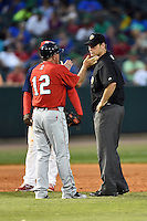 Oklahoma City RedHawks interim manager Tom Lawless (12) argues a call with umpire Brandon Misun during a game against the Memphis Redbirds on May 23, 2014 at AutoZone Park in Memphis, Tennessee.  Oklahoma City defeated Memphis 12-10.  (Mike Janes/Four Seam Images)