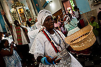 A Baiana woman performs the ritual dance in honor to Omolú, the Candomblé spirit syncretized with Saint Lazarus, inside the St. Lazarus church in Salvador, Bahia, Brazil, 30 January 2012. Every year on the last Sunday of January, the religious festival of Saint Lazarus takes place on a hill where the chapel of the same name was built in the 18th century. Faithful, of both the Catholic and Candomblé religions, dressed in the traditional white, usually undergo a purification cleansing ritual (banho de pipoca). As both Saint Lazarus and Omolú are related to diseases and healing, followers bring votive objects made of wax as a demonstration of gratitude and faith. The celebration ends with the festive Catholic Mass during which the elements of African mythology are present.