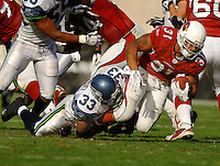 Nov. 6, 2005; Tempe, AZ, USA; Running back (31) Marcel Shipp of the Arizona Cardinals is tackled by safety (33) Marquand Manuel of the Seattle Seahawks at Sun Devil Stadium. Mandatory Credit: Mark J. Rebilas