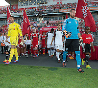 18 July 2012: Toronto FC goalkeeper Milos Kocic #30 and Colorado Rapids goalkeeper Matt Pickens #18 with the rest of the teams make there way onto the pitch during the opening ceremonies in an MLS game between the Colorado Rapids and Toronto FC at BMO Field in Toronto, Ontario..Toronto FC won 2-1..