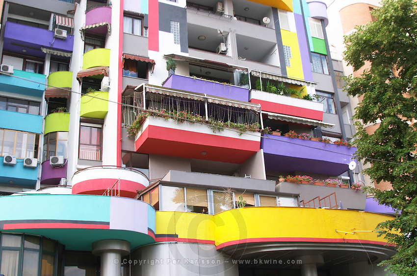 Detail with balconies of A very colourful building. Street scene from the part of the city called The Block that used to be reserved for party dignitaries during the communist era. Tirana capital. Albania, Balkan, Europe.