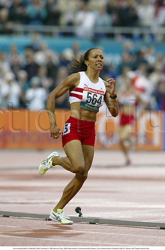 Gold medalist KELLY HOLMES (ENG), Women's 1500 Metres Final, 2002 Manchester Commonwealth Games, City of Manchester Stadium, 020731. Photo: Neil Tingle/Action Plus...athletics athletes athlete.runner runners running run runs.track event.winner.woman