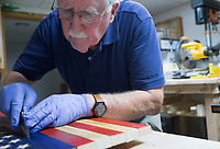 NWA Democrat-Gazette/CHARLIE KAIJO Don Lowe creates an American flag out of wood pieces, Monday, August 12, 2019 at his home in Bella Vista.<br /> <br /> Don Lowe and his grandson, Jeremiah Lowe, 11, turned their woodcrafting hobby into a business nine months ago after Don sold one of his wooden flags on Facebook within the first hour of posting it. It's a casual hobby he and his grandson share but they've sold 30 now in over four states, many to retired and active service members and emergency responders. He is working on a wooden flag he and his grandson will donate to the Bella Vista Fire Department.