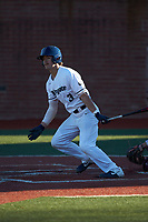 Carson Simpson (3) of the Wingate Bulldogs follows through on his swing against the Concord Mountain Lions at Ron Christopher Stadium on February 2, 2020 in Wingate, North Carolina. The Mountain Lions defeated the Bulldogs 12-11. (Brian Westerholt/Four Seam Images)