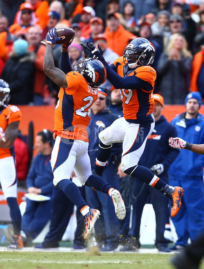 Jan 24, 2016; Denver, CO, USA; Denver Broncos defensive back Darian Stewart (26) intercepts the ball in front of linebacker Danny Trevathan (59) against the New England Patriots in the AFC Championship football game at Sports Authority Field at Mile High. The Broncos defeated the Patriots 20-18 to advance to the Super Bowl. Mandatory Credit: Mark J. Rebilas-USA TODAY Sportsin