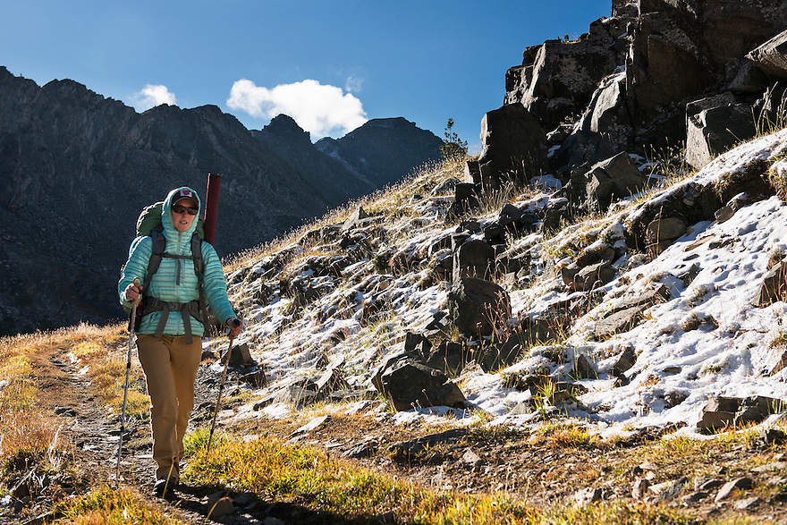 Christine Marozick, of Bozeman, Montana, backpacks below 10,000-foot peaks in the Tobacco Root Mountains south of Twin Bridges, Montana.