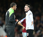 Manchester United's Wayne Rooney argues with the fourth official<br /> <br /> Barclays Premier League- West Ham United vs Manchester United  - Upton Park - England - 8th February 2015 - Picture David Klein/Sportimage