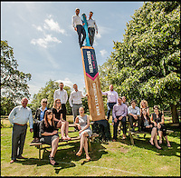 BNPS.co.uk (01202 558833)<br /> Pic: MikeKinsey/BNPS                                <br /> <br /> The team from Helmores Estate agents with the bat.<br /> <br /> A village cricket club has turned a beloved tree that has stood on the boundary of their ground for 125 years into a giant carving of a cricket bat after it was condemned.<br /> <br /> The 16ft tall wooden bat took a tree surgeon and an assistant 18 months to carve after members of Shobrooke Park Cricket Club couldn't bring themselves fell the storm-damaged Scots Pine.<br /> <br /> The tree was planted on the eastern edge of the boundary when the club in Crediton, Devon, was established in 1890 and has been a feature ever since.