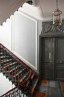 The landing and entrance of the apartment are in typical 19th century Haussmann style