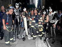 KISS poses with New York's city firemen