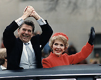 Ronald Reagan and Nancy Reagan waving from the limousine during the Inaugural Parade in Washington, D.C. on Inauguration Day , January 20, 1981.<br /> <br />  As Reagan read his inauguration address, 52 U.S. hostages (held by Iran for 444 days) were set free<br /> <br /> PHOTO : White House Photographic Office