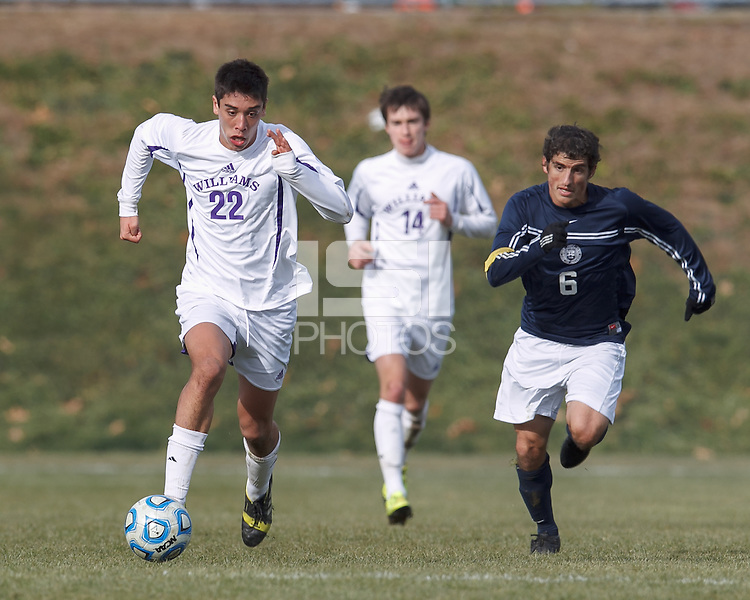 Williams midfielder Malcolm Moutenot (22) brings the ball forward as Brandeis midfielder/defender Ben Applefield (6) closes. NCAA Division III Sectionals. Williams College (white) defeated Brandeis University (blue/white), 2-0, on Hitchcock Field at Amherst College on November 23, 2013.