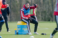 SWANSEA, WALES - JANUARY 28:  Ashley Williams sits and watches team mates during training  on January 28, 2015 in Swansea, Wales.