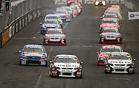 The V8s pull out for a warm-up lap in the feature race during Day Three of the Hamilton 400 Aussie V8 Supercars Round Two at Frankton, Hamilton, New Zealand on Sunday, 19 April 2009. Photo: Dave Lintott / lintottphoto.co.nz