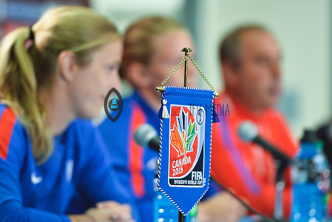 Fifa 2015 World Cup flag rest on the table as Netherlands' goal keeper Loes Geurts, Mandy Van Den Berg and Head Coach Roger Resigners address press conference on the even of the opening Women's World Cup Soccer match, June 05, 2015 in Edmonton, Alberta. (Mo Khursheed/TFV Media via AP Images)
