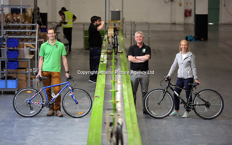 Pictured: Owners Jerry (L) and Shelley Lawson (R) and general manager Robert Mason (C) Monday 15 August 2016<br />Re: Frog Bikes in Mamhilad Estate Park in Pontypool, Wales, UK