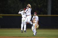 Ball State Cardinals Zach Plesac (11), Alex Call (8) and Matt Eppers (35) celebrate after a game against the Maine Black Bears on March 3, 2015 at North Charlotte Regional Park in Port Charlotte, Florida.  Ball State defeated Maine 8-7.  (Mike Janes/Four Seam Images)
