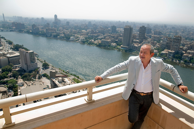 Egyptian billionaire Naguib Sawiris stands on the balcony of his home overlooking the Nile River on the top floor of Nile City Towers, Cairo, Egypt, Sept. 18, 2011. Sawiris, Chairman and CEO of Orascom Telecom, started a political party called the Free Egyptians and has thrown himself into politics in the wake of the uprising that toppled the regime of Hosni Mubarak.