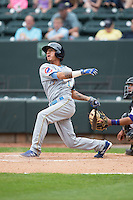 Carlos Penalver (1) of the Myrtle Beach Pelicans follows through on his swing against the Winston-Salem Dash at BB&T Ballpark on April 18, 2015 in Winston-Salem, North Carolina.  The Pelicans defeated the Dash 4-1 in game one of a double-header.  (Brian Westerholt/Four Seam Images)