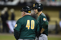 Siena Saints outfielder Dan Swain (22) talks with head coach Tony Rossi (40) during the opening game of the season against the UCF Knights on February 13, 2015 at Jay Bergman Field in Orlando, Florida.  UCF defeated Siena 4-1.  (Mike Janes/Four Seam Images)