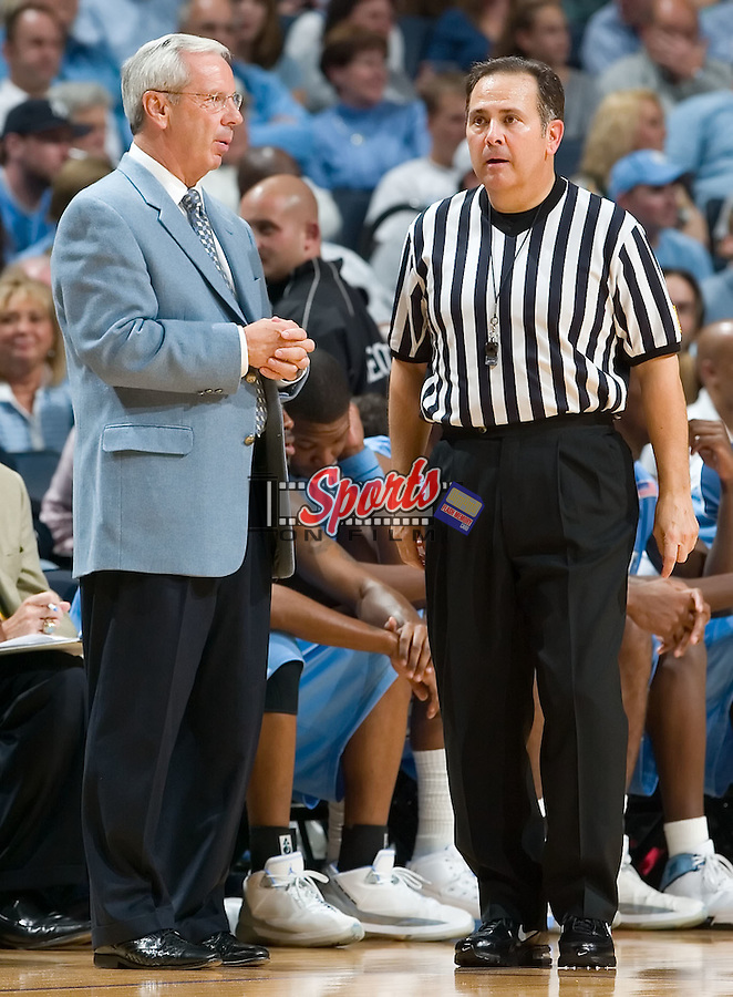 North Carolina head coach Roy Williams chats with official Mike Wood during second half action versus the Davidson Wildcats at Bobcats Arena on Wednesday, November 14, 2007 in Charlotte, NC.