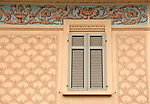 Decorated facade of a house with an elaborate border in the town of Molzano, in the hills above Menaggio on Lake Como, Italy