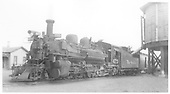 #473 K-28 with passenger train taking water at Antonito tank.<br /> D&amp;RGW  Antonito, CO