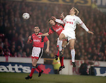 Jurgen Klinsmann of Bayern Munich challenges with Colin Cooper of Nottingham Forest - UEFA Cup - quarter final 2nd leg - Nottingham Forest v Bayern Munich - City Ground - Nottingham - England - 19th March 1996 - Picture Simon Bellis/Sportimage