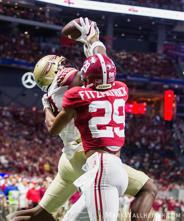 FSU's Auden Tate goes up for a touchdown reception against Alabama's Minkah Fitzpatrick (29) in the first half of the Chick-fil-A Kickoff game at the new Mercedes-Benz Stadium in Atlanta, Georgia on September 2, 2017.   Photo by Mark Wallheiser/UPI