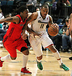 Reno Bighorns Will Blalock drives past Idaho Stampede's David Bailey during a basketball game Sunday, April 1, 2012 in Reno, Nev. Idaho won 108-99..Photo by Cathleen Allison