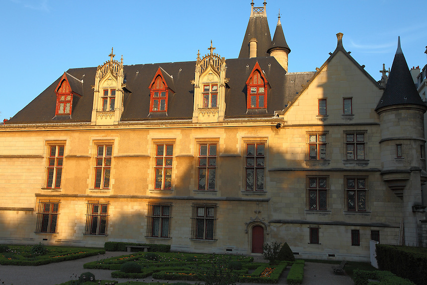 The façade onto the garden of the Hotel de Sens in the Marais, Paris in the late afternoon.  The building was the residence of the archbishops of Sens in the town from the end of the XIV century, and it has been entirely rearranged by one of them, Tristan de Salazar, at the end of the XV century. It has been restored at the beginning of 1900. Digitally Improved Photo.