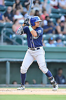 Right fielder Yonathan Daza (2) of the Asheville Tourists bats in a game against the Greenville Drive on Thursday, August 13, 2015, at Fluor Field at the West End in Greenville, South Carolina. Asheville won, 8-1. (Tom Priddy/Four Seam Images)