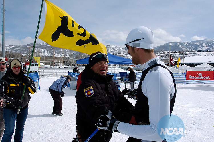 11 MAR 2006: Kit Richmond of the University of Colorado - Boulder celebrates with his coach Richard Rokos following the Men's 20K Freestyle Cross Country event at the 2006 NCAA Men and Women's Skiing Championships held at Howelsen Hill in Steamboat Springs, CO, hosted by the University of Colorado - Boulder. Richmond placed 1st in the event to win the national title.  Brett Wilhelm/NCAA Photos