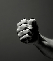Male hand clenched in a fist.