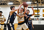 WATERBURY, CT. 09 January 2020-010920BS217 - Wolcott Tech's Jordan Schaer (1), right, comes from behind trying to knock the ball away from Kaynor Tech's Scott Dalesio (2) as he drives to the basket against Wolcott Tech's Blake Sanford (22), during a Boy Basketball game between Wolcott Tech and Kaynor Tech at Kaynor Tech in Waterbury on Thursday. Bill Shettle Republican-American