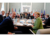 Heiligendamm, Germany - June 7, 2007 -- First working session of the G-8 Heads of State and Government chaired by Angela Merkel in the Kurhaus building in Heiligendamm, Germany on Thursday, June 7, 2007.  Pictured in the foreground are United States President George W. Bush, left, and Chancellor Angela Merkel of Germany, right.  Also visible in the photo are, from left, Prime Minister Tony Blair of the United Kingdom, Prime Minister Romano Prodi of Italy, President of the European Commission José Manuel Barroso, Prime Minister Shinzo Abe of Japan, and Vladimir Putin of Russia..Mandatory Credit: BPA via CNP