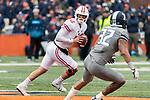 Wisconsin Badgers quarterback Alex Hornibrook (12) looks for a receiver during an NCAA College Big Ten Conference football game against the Illinois Fighting Illini Saturday, October 28, 2017, in Champaign, Illinois. The Badgers won 24-10. (Photo by David Stluka)