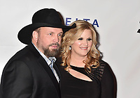 LOS ANGELES, CA - FEBRUARY 08: Garth Brooks (L) and Trisha Yearwood attend MusiCares Person of the Year honoring Dolly Parton at Los Angeles Convention Center on February 8, 2019 in Los Angeles, California.<br /> CAP/ROT/TM<br /> &copy;TM/ROT/Capital Pictures
